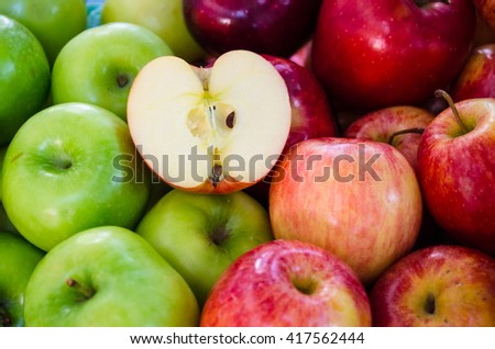 half apple on group of green and red apples - stock photo