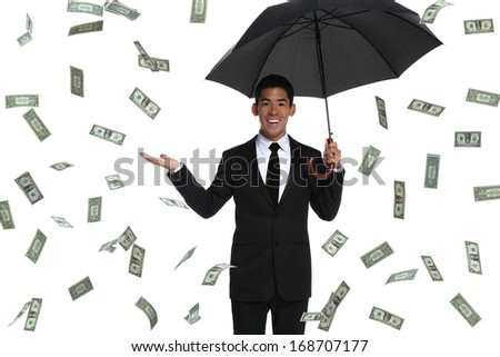 Half-body of a business man holding an umbrella in raining money holding his hand out
