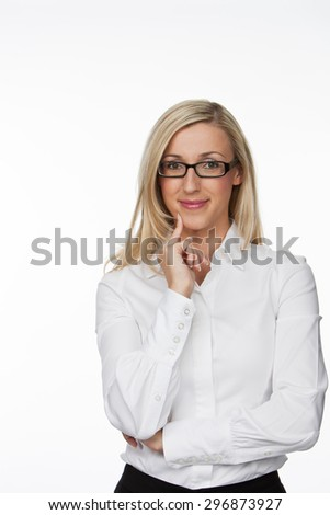 Half Body Shot of an Optimistic Young Businesswoman with Eyeglasses, Smiling at the Camera with Hand on her Face. Isolated on White Background.