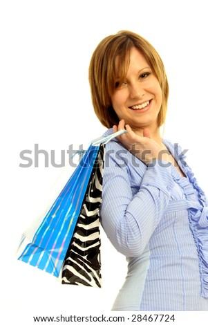 Half body view of young attractive woman doing shopping with lots of shopping bags. Isolated on white background.