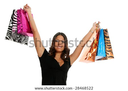 Half body view of young attractive woman doing shopping with lots of shopping bags. Isolated on white background. - stock photo