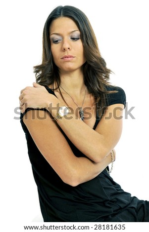 Half body view of young lovely woman in chic wear embracing herself. Isolated on white background. - stock photo