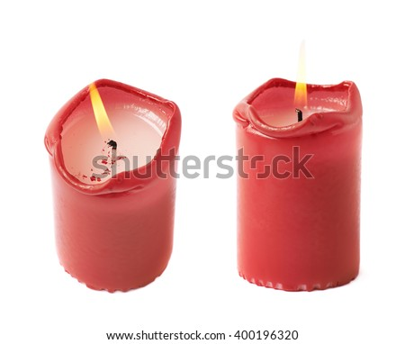 Half-burned lit red candle isolated - stock photo