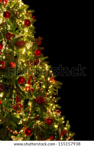Half christmas tree cut out on black with copy space - stock photo