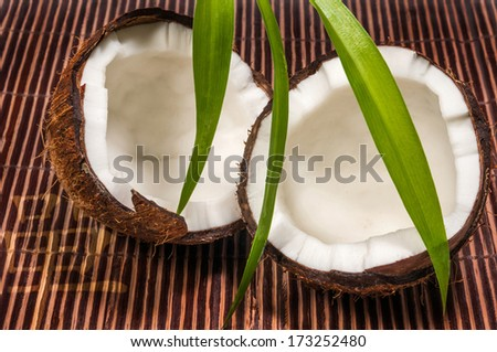 Half coconut on a bamboo mat - stock photo