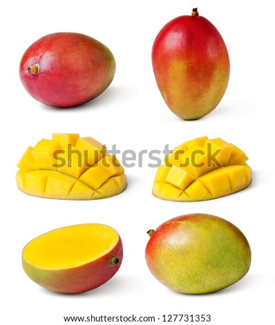 Half cut and whole mango fruits on white background