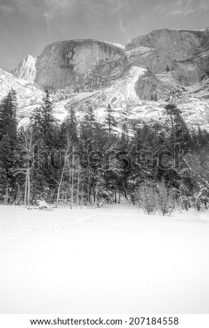 Half Dome in Yosemite National Park, as seen from a frozen Mirror Lake.  In black and white. - stock photo