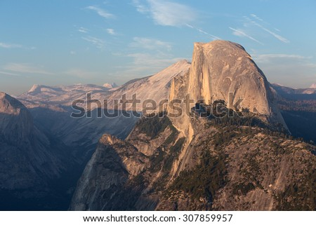 Half Dome peak in sunset light from Glacier Point trailhead. Sierra Nevada mountains, Yosemite National Park, California