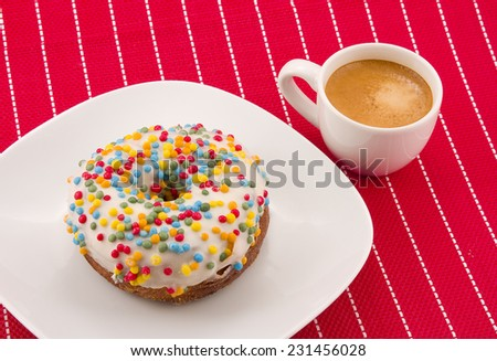Half-donut and half-croissant pastry, and milk coffee cup. - stock photo