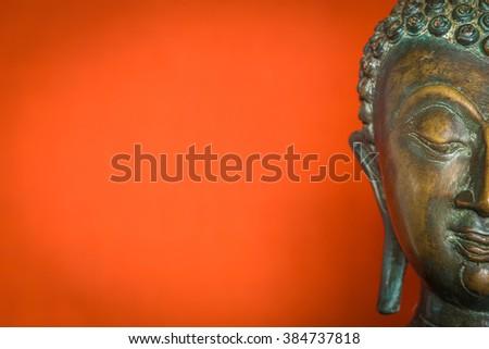 half face buddha statue - stock photo