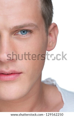 Half face close up portrait of a handsome young man - stock photo