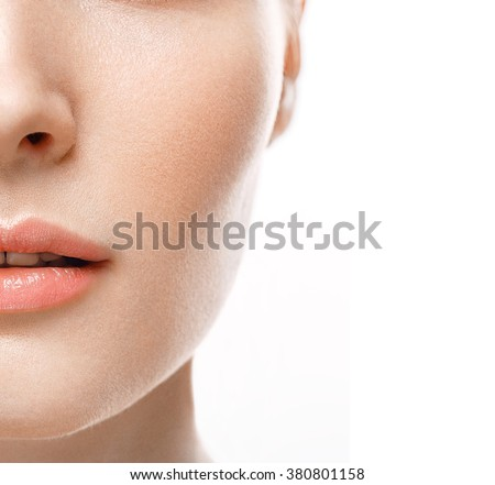 Half face female beauty portrait with healthy skin and Rose color lips