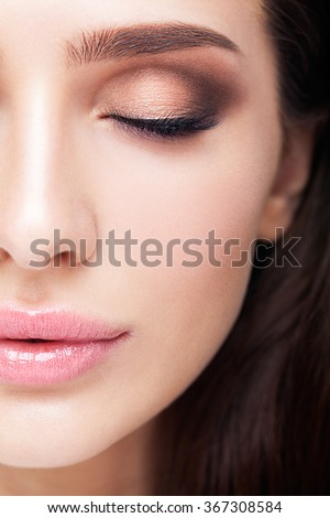 Half face female beauty portrait with makeup in 2016 year colors - aqua Limpet Shell color eye shadows, Snorkel Blue colour liner and Rose Quartz lips - stock photo