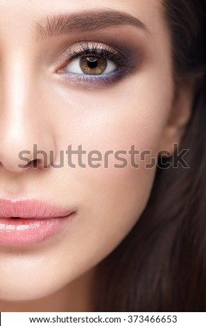 Half face female beauty portrait with makeup in 2016 year colors - aqua Limpet Shell color eye shadows, Snorkel Blue colour liner and Rose Quartz lips
