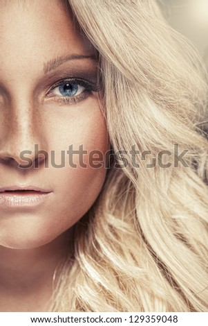 Half face of a beautiful blonde