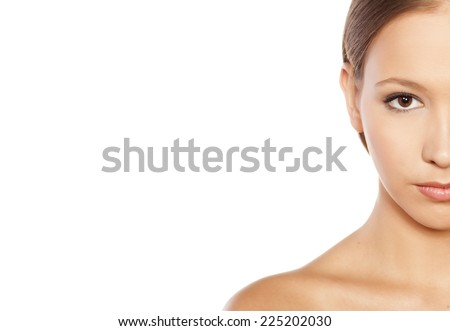half face of beautiful girl on white background - stock photo