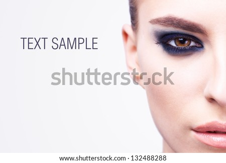 half face of beautiful young passion woman - stock photo