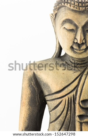 half face of Buddha wood carving on isolated on white background