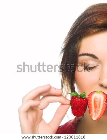 Half face of young girl with fresh  strawberries - stock photo