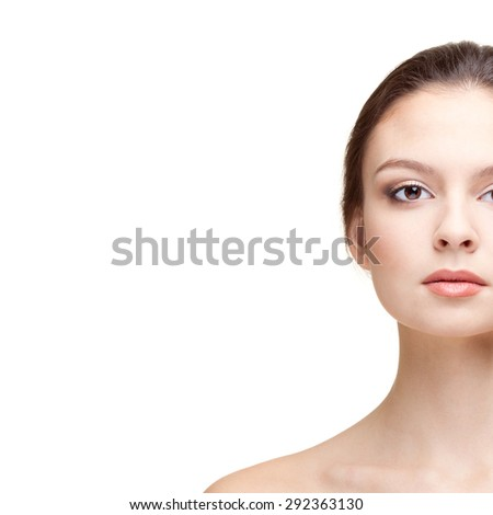 Half-face Portrait of Beautiful Young Woman on the Blue Background. Head and Shoulders. Copy Space - stock photo