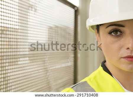 Half Face Portrait Of Female Engineer