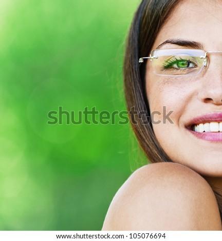half face young beautiful girl dark closeups short hair glasses summer park smiling - stock photo