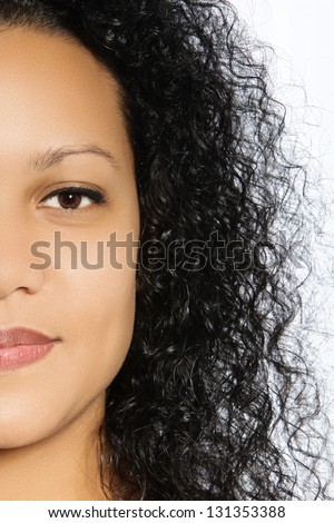 Half faced portrait of a beautiful girl with black curly hair - stock photo