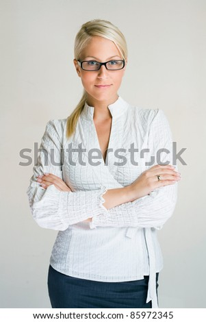 Half figure portrait of smiling confident young business woman. - stock photo