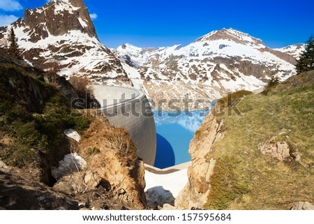 Half filled Emosson hydroelectric Dam and lake near village of Chatelard, Swiss on the border with France - stock photo