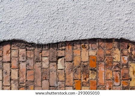 Half finished brickwork and plaster background texture - stock photo