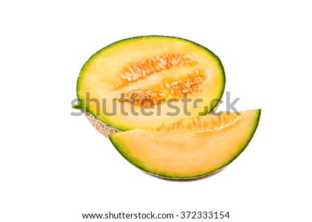 Half fresh melon with a slice of cantaloupe on a white background - stock photo