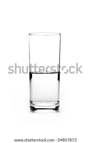 Half full glass of water is isolated on a white background - stock photo