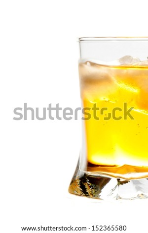 half glass of fresh drink with ice on white background - stock photo