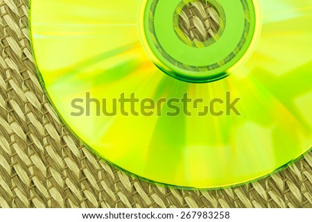 Half Green CD Placed on a Japanese Mat - stock photo