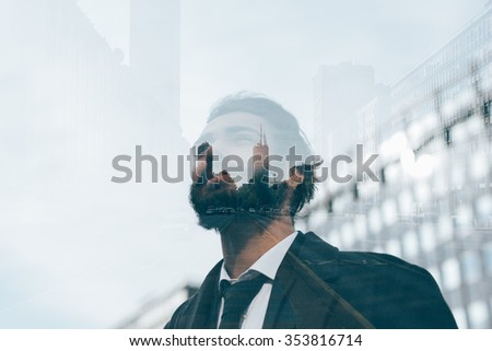 Half length double exposure portrait of young caucasian brown hair bearded man. - stock photo