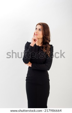 Half length portrait of a beautiful young business woman thinking against white background. Looking sideways. - stock photo