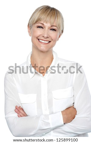 Half length portrait of a charming executive posing with arms crossed. - stock photo