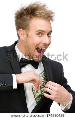 Half-length portrait of businessman hiding money, isolated on white. Concept of wealth and income