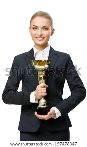 Half-length portrait of businesswoman keeping golden cup, isolated on white. Concept of victory and success