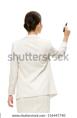 Half-length portrait of businesswoman writing with marker on imaginary screen, isolated on white. Concept of leadership and success