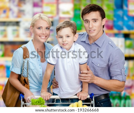 Half-length portrait of family in the market. Concept of consumerism and family relations - stock photo