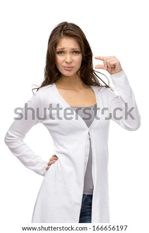 Half-length portrait of girl showing small amount of something, isolated on white