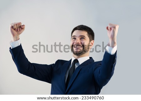 Half-length portrait of handsome young bearded happy man wearing white shirt tie and blue jacket satisfied with the successful interview. Isolated on white background - stock photo