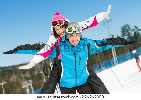Half-length portrait of happy couple of alps skiers have fun. Concept of winter sports and cute vacations - stock photo