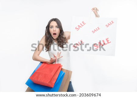 Half-length portrait of nice but scared girl, paying high price for goods at cut rate. Isolated on the white background - stock photo