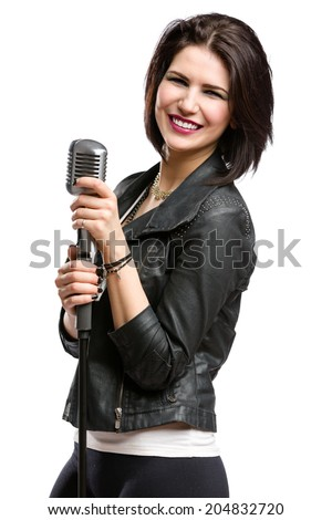 Half-length portrait of rock singer wearing leather jacket and keeping static mic, isolated on white. Concept of rock music and rave - stock photo