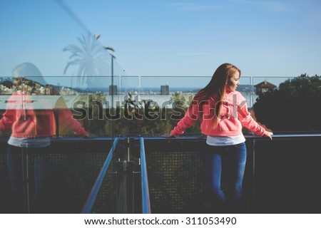 Half length portrait of stylish hipster girl posing outdoors with copy space area for your advertise text message, attractive female dressed in trendy basic clothes looking away, filtered image - stock photo