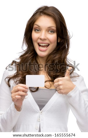 Half-length portrait of woman keeping business card and thumbing up, isolated on white - stock photo