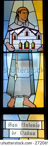 HALF MOON BAY CA USA APRIL 12: San Antonio de Padua (Saint Anthony of Padua) stained glass window in Our Lady of the Pillar Church on april 12 2015 in Half Moon Bay, CA,  - stock photo