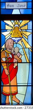 HALF MOON BAY CA USA APRIL 12: San Jose for saint Jose stained glass window in Our Lady of the Pillar Church on april 12 2015 in Half Moon Bay, CA,  - stock photo